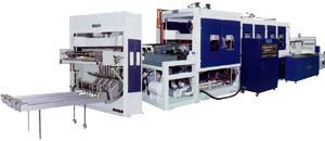 Вакуум-формовочный автомат с автоматическим вырубным прессом. Нажмите для просмотра.