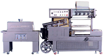 Промышленный автомат ТМ-100MU для упаковки в термоусадочную плёнку-полурукав.